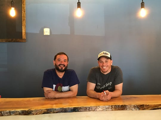 Long-time friends Jordan Paul Taylor, left, and Barry Putzke pose for a photo in May in their under-construction Bread & Circus Sandwich Kitchen at 600 N. Main Ave., Suite 110 in Sioux Falls.