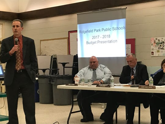 Eric Koenig, left, the former Ridgefield Park superintendent of schools, at a 2017 school board meeting.