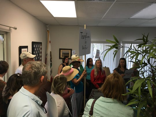Members of the group Shasta Women Together showed up Monday at U.S. Rep. Doug LaMalfa's Redding office to protest his vote to repeal and replace the Affordable Care Act.