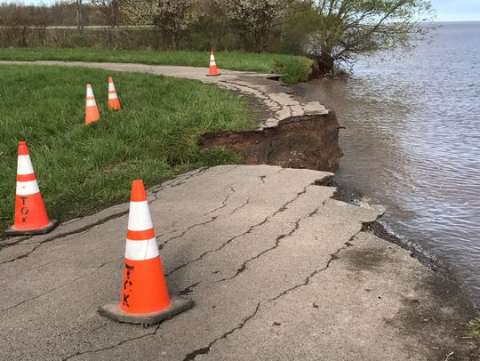 Erosion has washed away a road on Thompson Drive in