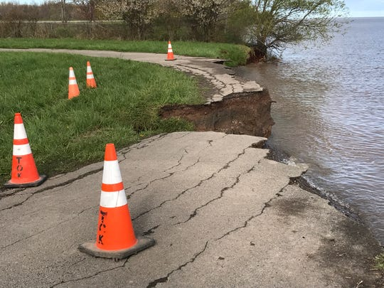 Erosion has washed away a road on Thompson Drive in Kendall, Orleans County.