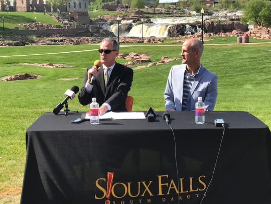 Gov. Dennis Daugaard, left, and Tourism Secretary Jim