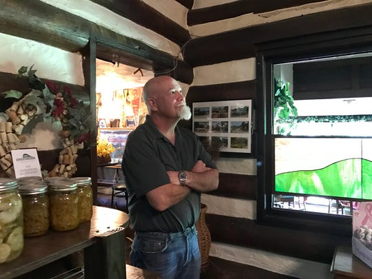 In this file photo, David Hadden, owner of Greenbrier Restaurant, watches as a crew from Lone Wolf Construction makes repairs to his restaurant after four trees fell on it and broke through the roof.