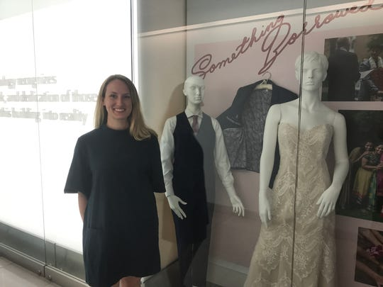 """Cornell senior Kennedy Rauh curated the """"Something Old, Something New, Something Borrowed, Something Blue"""" exhibit on display in the Human Ecology Building."""