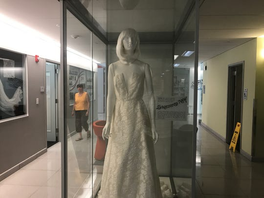 """A wedding gown from the """"Something Old, Something New, Something Borrowed, Something Blue"""" exhibit at Cornell."""