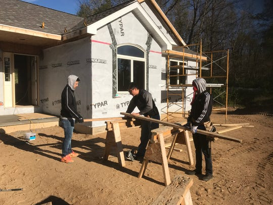 CACC students work on the house Tuesday morning.