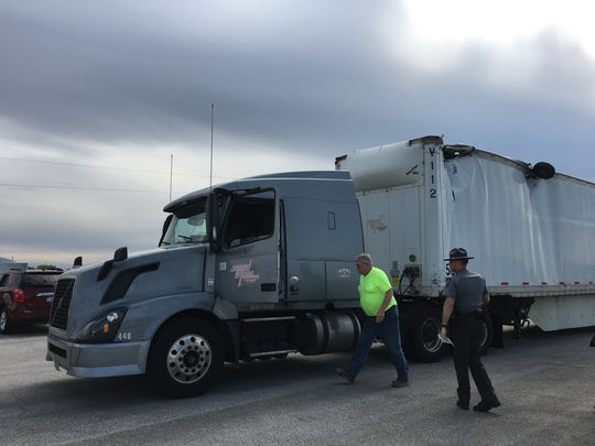 No injuries were reported after a Piper airplane clipped this truck, driven by Russell Street of South Shore Transportation, and crashed at the Fremont Airport Tuesday. The [plane's wheel was embedded in the top of the truck.