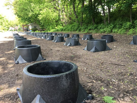 Stabilizer pots await the delivery of young trees to