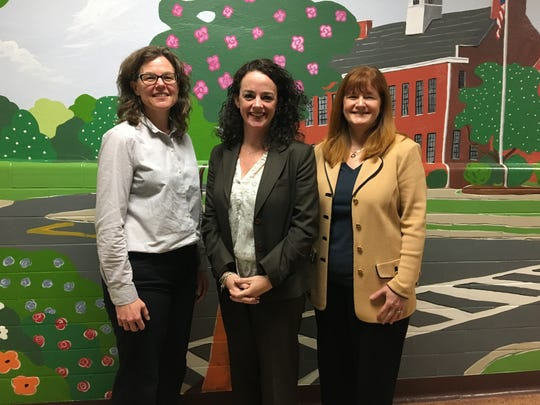Mary Asfendis, newly appointed principal of Roosevelt Intermediate School in Westfield, is congratulated by Board of Education President Gretchan Ohlig (left) and Superintendent of Schools Dr. Margaret Dolan.