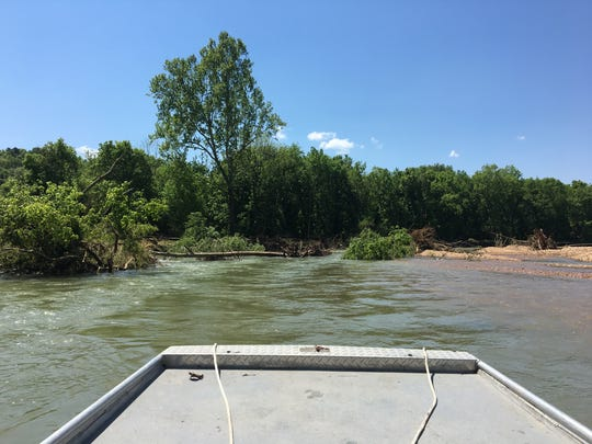 A tangle of trees and gravel pushed by the April 29 flood blocks a section of the Jacks Fork River.