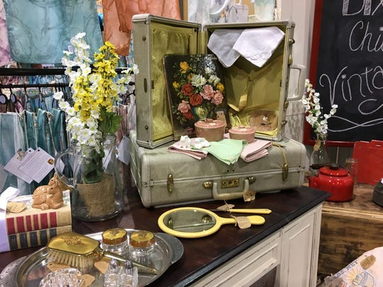 Small suitcases and sundry items are sold at a booth owned by Amy Dixon and Jessica Kibling, of Harrison, Arkansas. A mother and daughter, Dixon and Kibling show 'Dixon Chicks' wares at Branson Market Days on Friday and Saturday at the convention center.