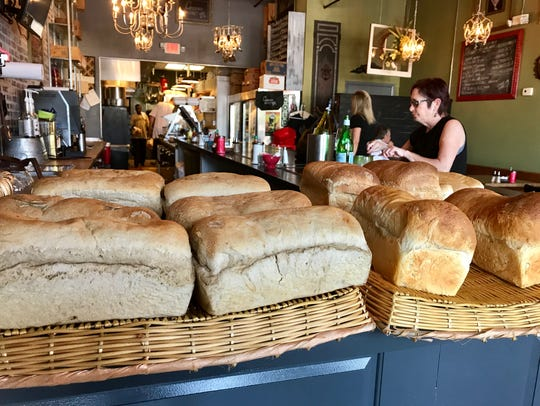 House-baked bread cools on the counters at Crave. The