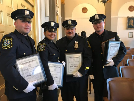 Bloomfield Police Officer Matthew Rubbinaccio, Officer Ana Ruiz, Officer Jose Alicea and Officer Donny Grey, from left, show off their awards during the Monday, May 16, 2017 police awards ceremony held in the Council Chambers.
