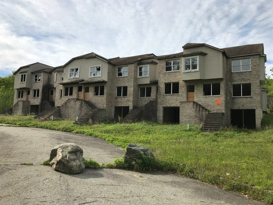 Wanaque officials are pushing for the demolition of the decaying Lakeside Manor residential project that was abandoned in 2002. Neighbors describe the site as a 'horror' and say their property values have suffered as a result of the unfinished project.