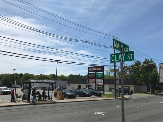 The site of the proposed fried chicken restaurant sits next-door to a CVS pharmacy and adjacent to large shopping center on Main Avenue.