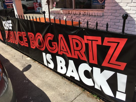 A sign outside Moe's Market and Deli announces that Chef Bruce Bogartz is cooking there.