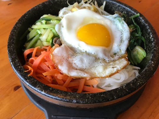 Dolsot-bibimbap is served in a hot stone bowl that
