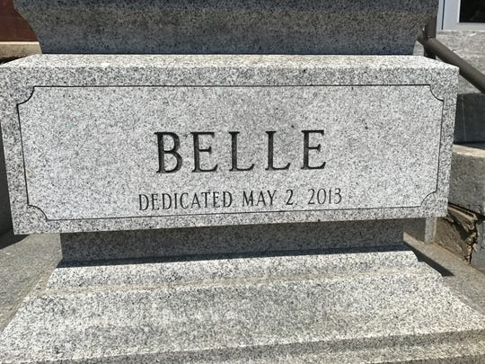 The base of statues outside of the Belleville Public Library and Information Center bear the birthdate of Richard Yanuzzi, a convicted felon.
