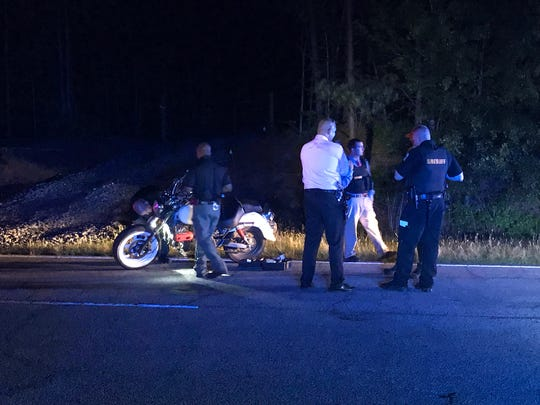 Anderson County Sheriff's Office deputies work at the scene after a deputy attempted a traffic stop on a motorcyclist Wednesday night.