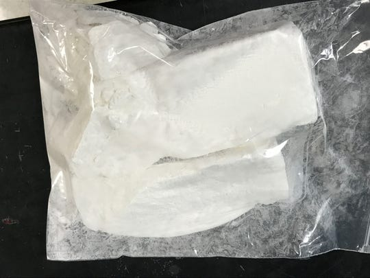 Pictured is a mixture of approximately 500 grams of acrylfentanyl and fentanyl from a drug bust. The drug was being tested at the Hamilton County Crime Lab on May 16. Along with this, the bust also included 1,000 grams of a fentanyl. Workers in the crime lab have increased safety and security due to the deadly substances. The crime lab is part of the coroner's office under the direction of Dr. Lakshmi Sammarco.