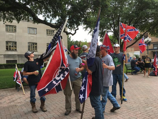Members of the Gulf Coast Patriot Network waved Confederate flags in front of the Caddo Courthouse on Thursday to show support for the Shreveport Confederate monument.