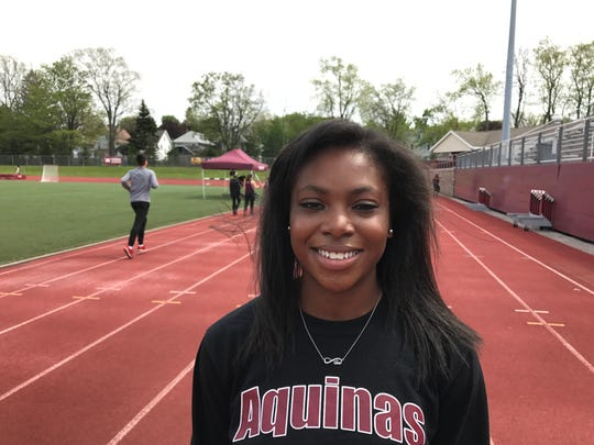Travasia Singletary, Aquinas junior track and field sprinter and long jumper