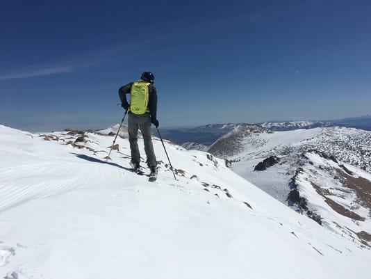 636308087115022993-Skiing-off-Freel.jpg