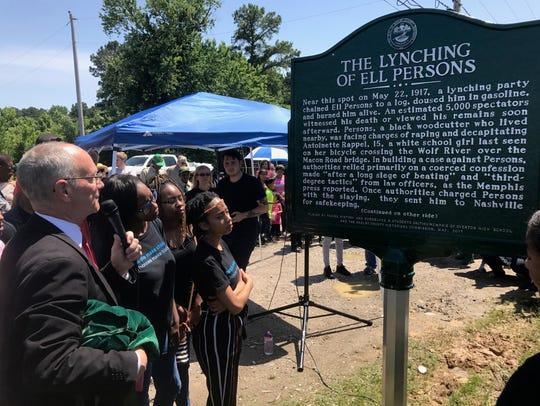 Shelby County Historian Jimmy Ogle reads the marker