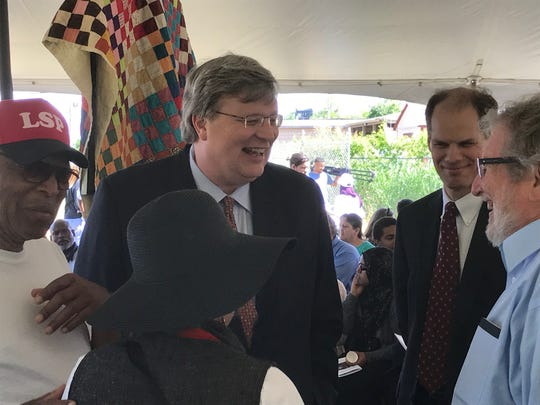 Memphis Mayor Jim Strickland greets attendees at an interfaith prayer ceremony.