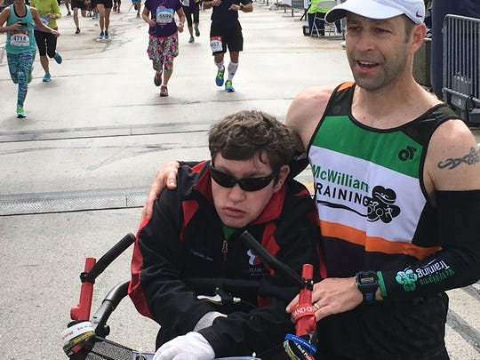 Jacob Vandenberg (left) and Brian McWilliams finished the Cellcom Green Bay Marathon in under 3 hours, 15 minutes.