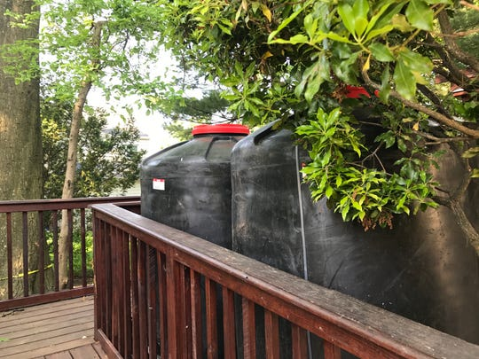 Rain barrels at Beverly Luchfeld's home in Teaneck.