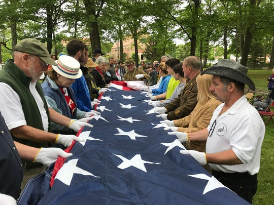 Attendees at the World War I bazaar at The Hermitage in Ho-Ho-Kus learned the proper way to fold the American Flag