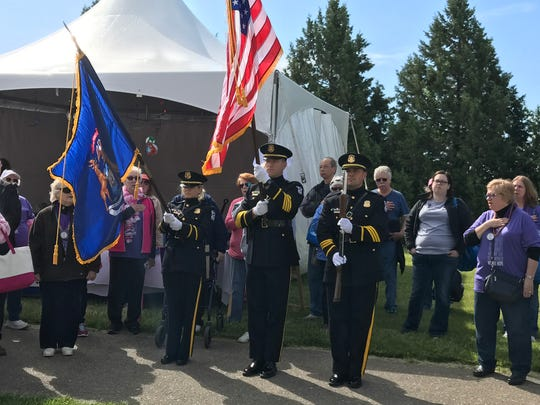 The Canton Police Department Honor Guard posts the colors at the start of the 2017 Relay for Life in Heritage Park.