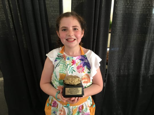 Evie Braud, 11, of Knoxville, won the student competition during the 2017 International Biscuit Festival. Her entree was a cheddar blueberry supreme biscuit.