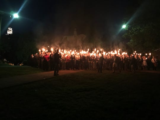 People gather at Lee Park in Charlottesville, Va.,