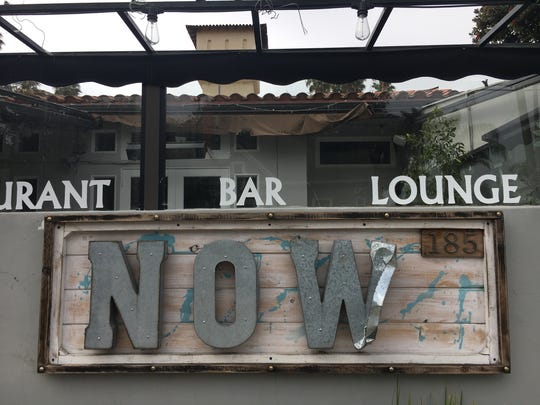 Metal peels away from a sign at NOW Ventura in downtown Ventura. The Italian restaurant and night club closed this month, about 17 months after its debut next to the Clocktower Inn.