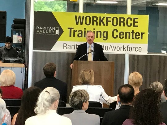 Raritan Valley Community College President Michael J. McDonough welcome attendees at the official opening ceremonies May 23 for the Workforce Training Center at the Branchburg-based college.