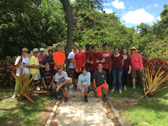 Calusa Garden Club members and MIA students.