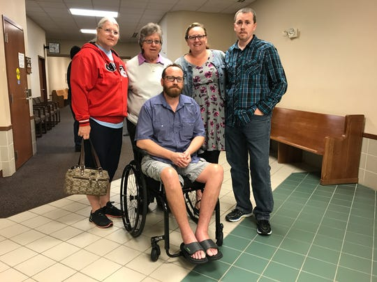 After being shot last October, Richard Love is paralyzed and uses a wheelchair. He is pictured with his family outside of the courtroom in 2017, following a hearing for Greg Marvin. Standing (from left) are Bev Long, his mom Betty Love, and siblings Angie Kind and Chris Love.