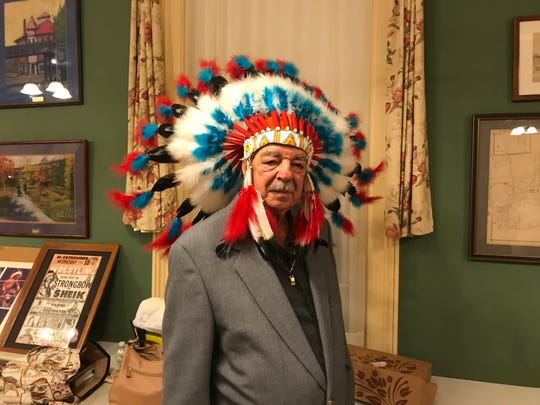 Sal Scarpa tries on his brother Chief Jay Strongbow's headdress at the Nutley Museum's wrestling program.