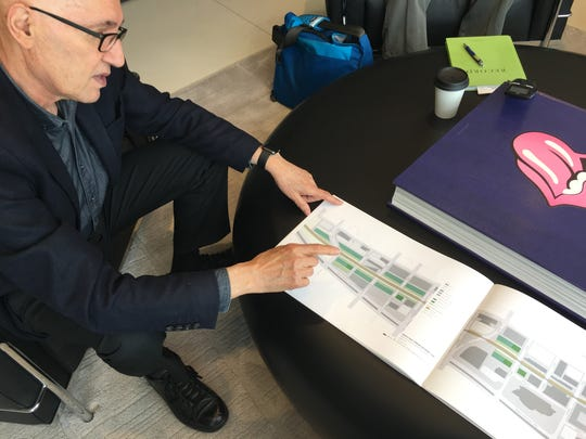 Mario Gandelsonas shows plans for the Des Moines Agricultural Corridor, a string of massive greenhouses on the south side of downtown Des Moines. Gandelsonas, a New York architect, and a group of local business leaders are trying to drum up support for the idea.