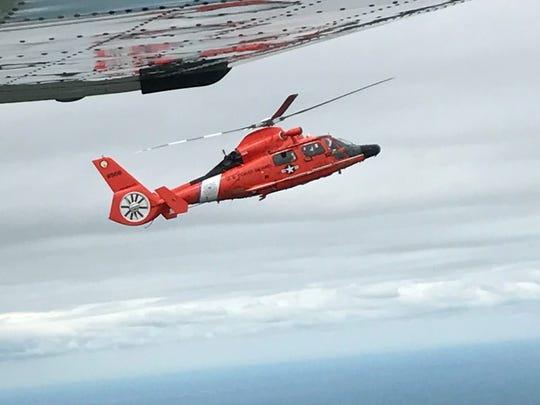 A Coast guard helicopter engages a Civil Air Patrol