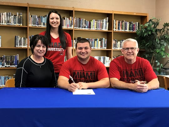 Seth Hoffman, surrounded by his mother Beth, father Mike and sister Taylor, signs his letter of intent to attend Miami University.