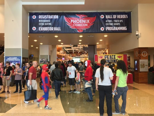 Phoenix Comicon-goers file through the entrance on