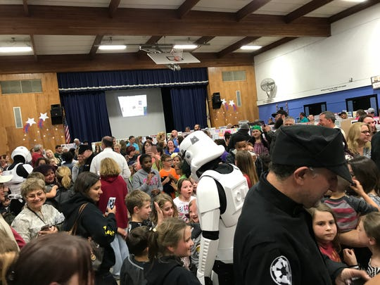 Stormtroopers mingle with a capacity crowd at the 2017 Upper Greenwood Lake Elementary science fair in West Milford.