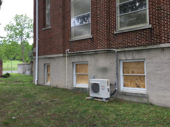 Windows that were shattered at Basic United Methodist Church in Waynesboro, Va., are now boarded up. Photo taken Friday, May 26, 2017.