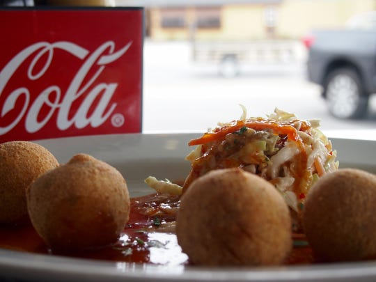 Shrimp & Grits Hushpuppies stuffed with cheese grits and fresh shrimp.