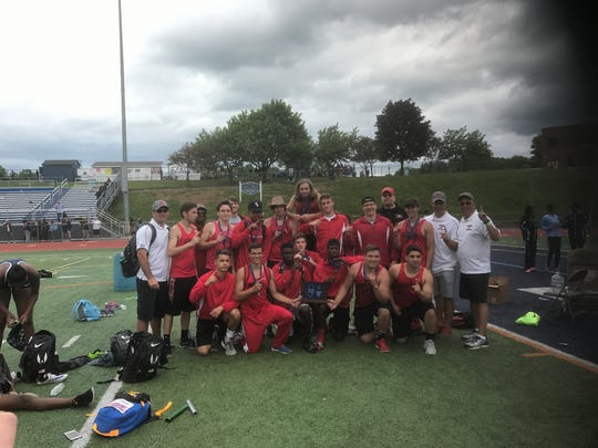 The Boonton boys track and field team poses with the North 1, Group 1 trophy.