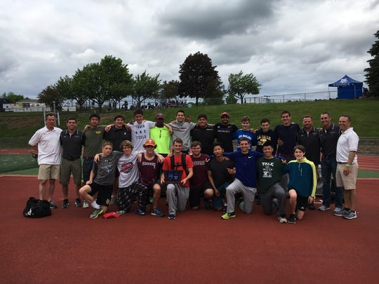 The Ridgewood boys track and field team poses with the North 1, Group 4 trophy.