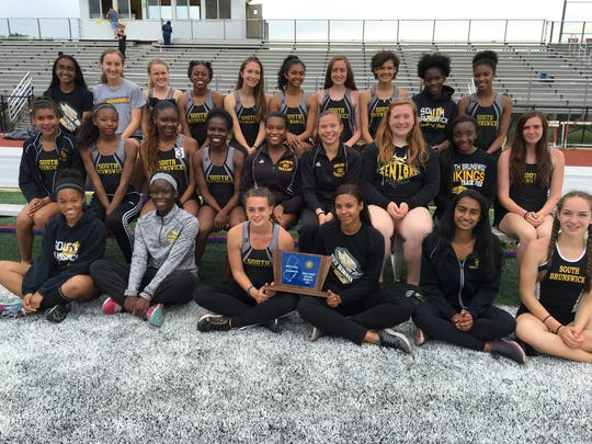 Members of the South Brunswick girls track team pose with the Central Group 4 trophy.